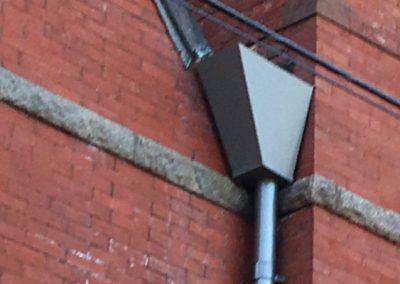 Nordic Steel Gutters with Custom Conductor Head in Dark Bronze